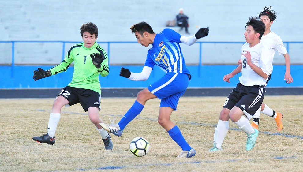 Prescott's Claudio Orozco takes a shot on goal as the Badgers take on the Coconino Panthers Wednesday, Jan. 23, 2019 in Prescott. (Les Stukenberg/Courier).