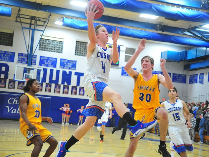 Chino Valley's Thomas Bartels goes airborne to the basket as they face the Kingman Bulldogs Thursday, Jan. 24, 2019 in Chino Valley. (Les Stukenberg/Courier)