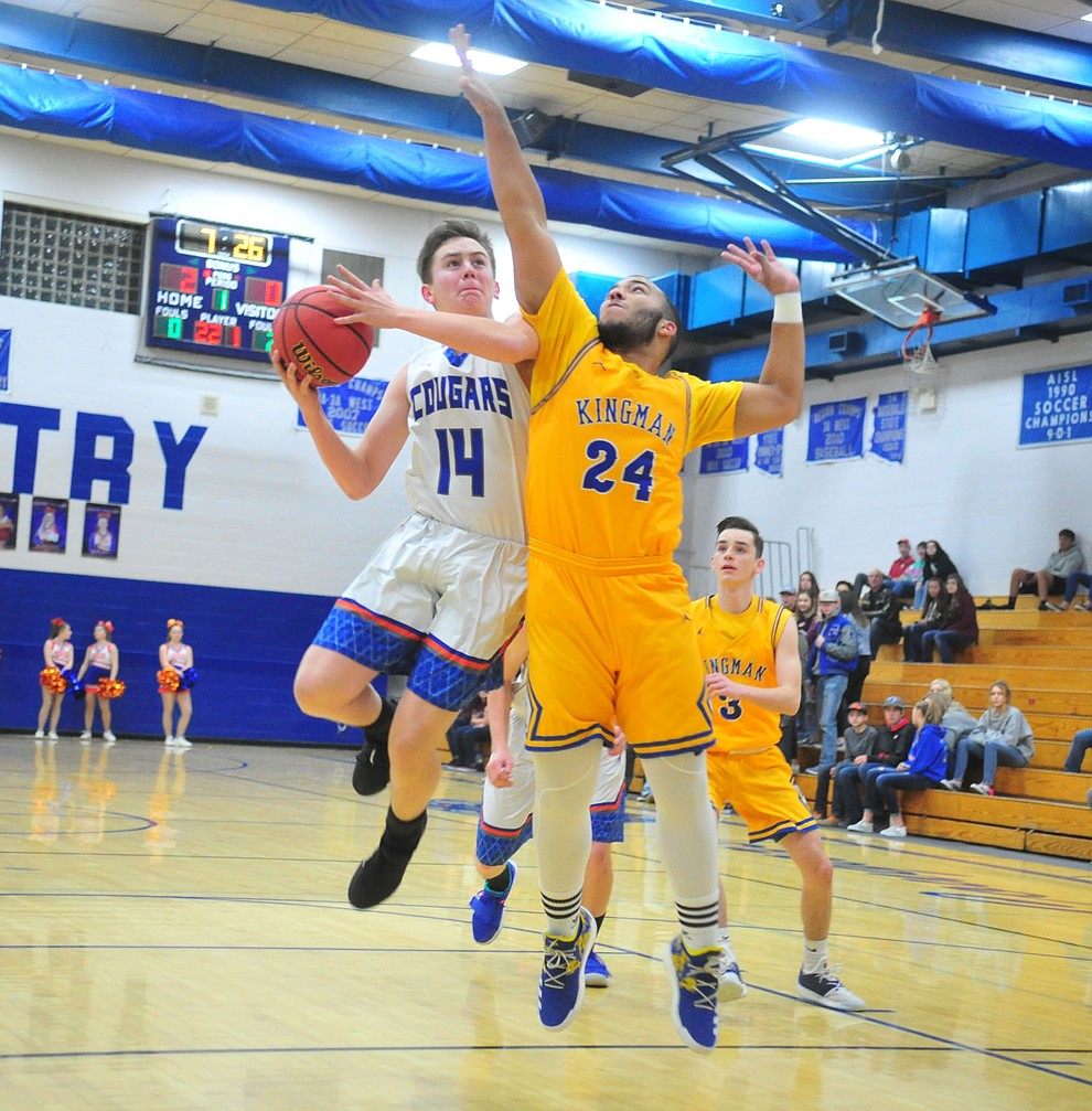 Chino Valley's Cody Burns goes up hard in the lane as they face the Kingman Bulldogs Thursday, Jan. 24, 2019 in Chino Valley. (Les Stukenberg/Courier).