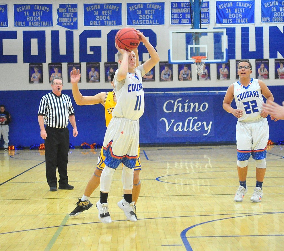 Chino Valley's Kaleb Burns shoots a long two-pointer as they face the Kingman Bulldogs Thursday, Jan. 24, 2019 in Chino Valley. (Les Stukenberg/Courier).