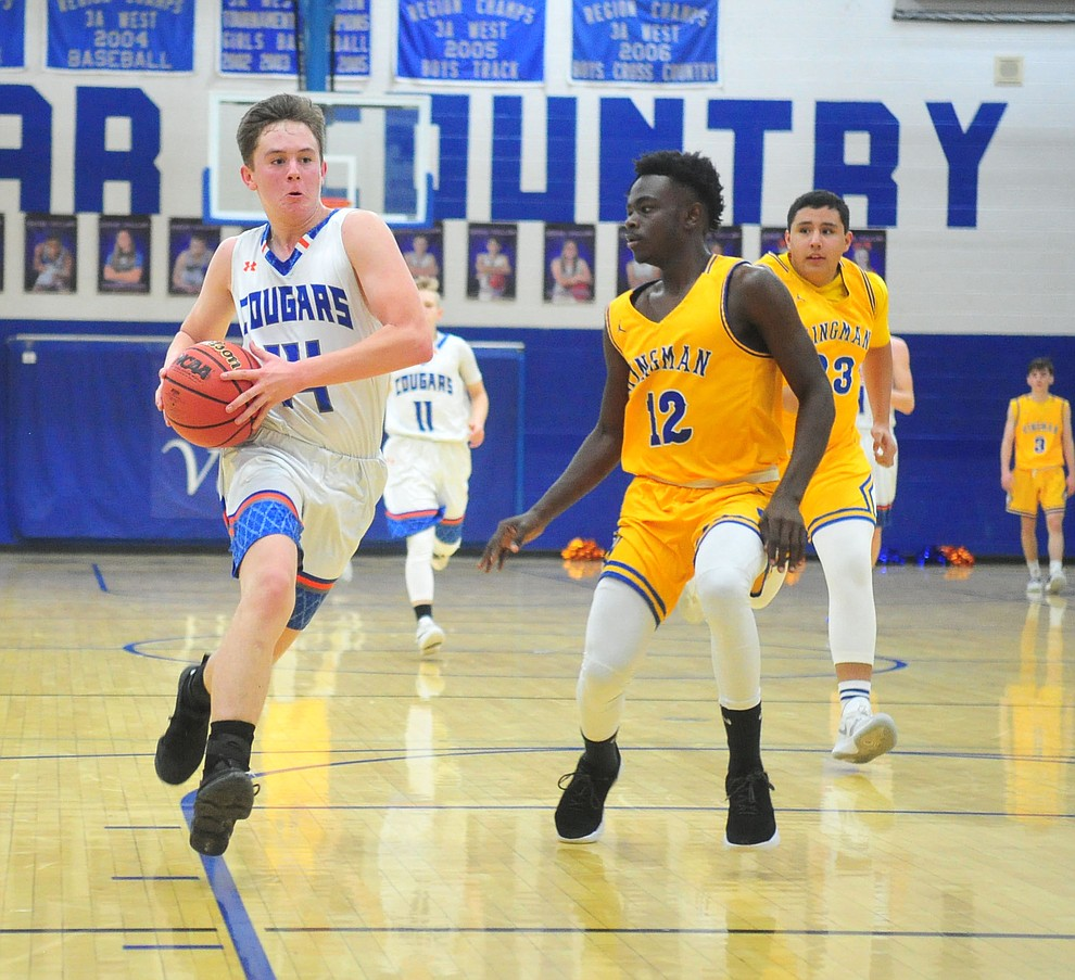 Chino Valley's Cody Burns heads towards the basket on a fast break as they face the Kingman Bulldogs Thursday, Jan. 24, 2019 in Chino Valley. (Les Stukenberg/Courier).