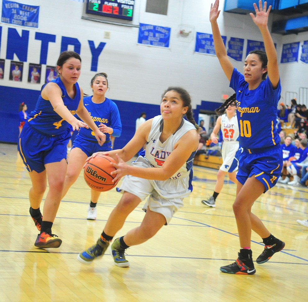 Chino Valley's Trinity Tomkins drives into the lane as they face the Kingman Bulldogs Thursday, Jan. 24, 2019 in Chino Valley. (Les Stukenberg/Courier).