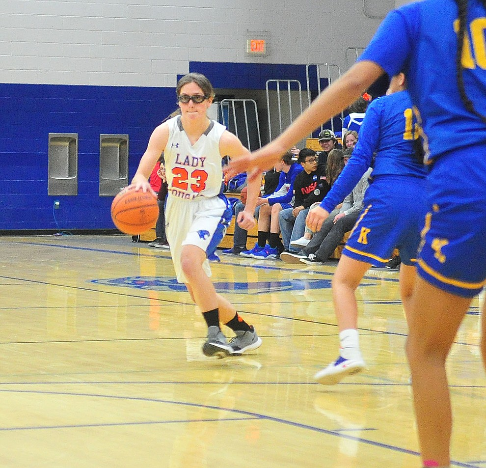 Chino Valley's Abbie Golden brings the ball upcourt as they face the Kingman Bulldogs Thursday, Jan. 24, 2019 in Chino Valley. (Les Stukenberg/Courier).