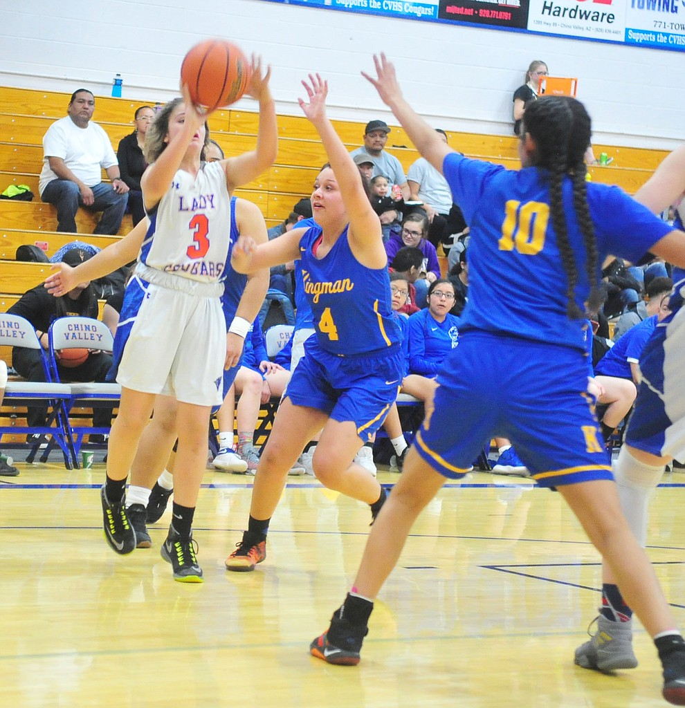 Chino Valley's Coury Hawks takes a contested jump shot as they face the Kingman Bulldogs Thursday, Jan. 24, 2019 in Chino Valley. (Les Stukenberg/Courier).