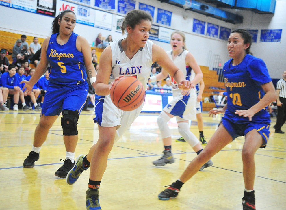 Chino Valley's Trinity Tomkins drives the baseline as they face the Kingman Bulldogs Thursday, Jan. 24, 2019 in Chino Valley. (Les Stukenberg/Courier).