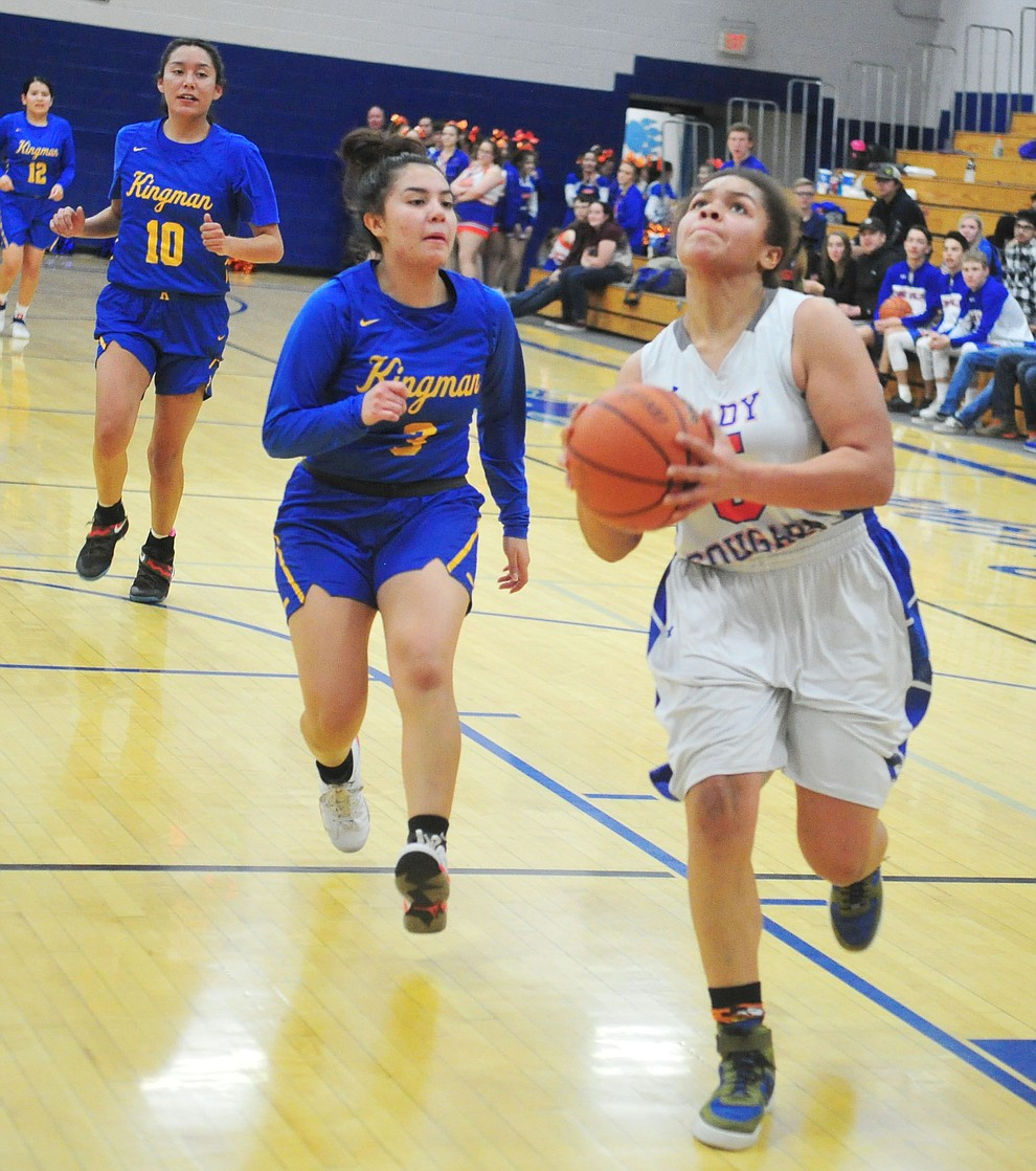 Chino Valley's Trinity Tomkins goes in for a basket at the end of the first half as they face the Kingman Bulldogs Thursday, Jan. 24, 2019 in Chino Valley. (Les Stukenberg/Courier).