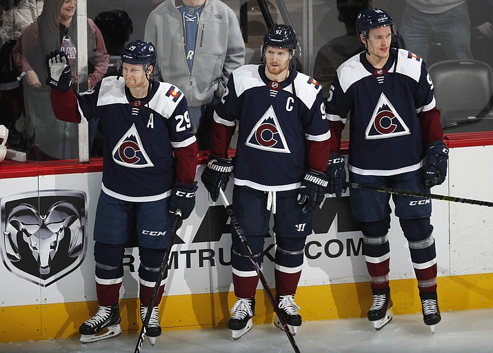 From left, Colorado Avalanche center Nathan MacKinnon, left wing Gabriel Landeskog and right wing Mikko Rantanen, who are headed to play in the All-Star Game, are introduced after a video tribute in the first period of an NHL hockey game against the Minnesota Wild, Wednesday, Jan. 23, 2019, in Denver. (David Zalubowski/AP)