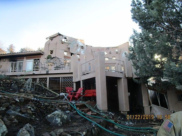 The hollow ruins of a home in the 3100 block of Rainbow Ridge Drive in Prescott that all but burned to the ground Tuesday, Jan. 22.