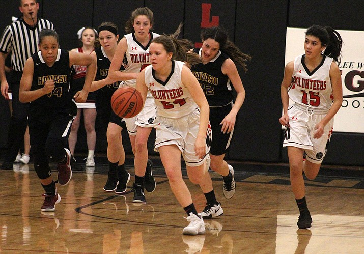 From left, Lee Williams' Ellie Thomas, Liberty Cronk and Amya Sellars get a fast break opportunity Thursday night against Lake Havasu. Cronk finished with seven points in a 50-40 victory. (Photo by Beau Bearden/Daily Miner)