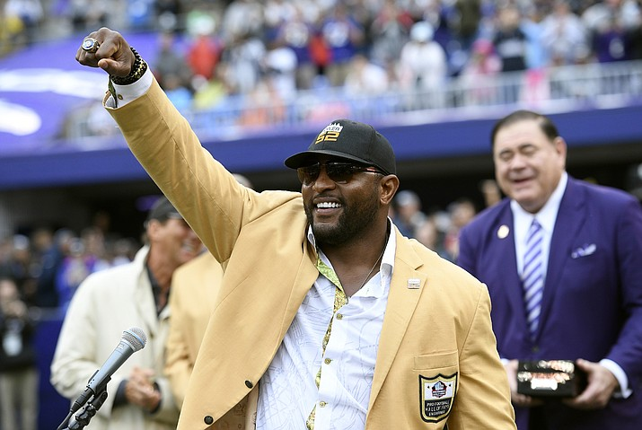 In this Sept. 23, 2018, file photo, former Baltimore Ravens linebacker Ray Lewis displays his Hall of Fame ring of excellence that he received at a halftime ceremony during an NFL football game between the Ravens and the Denver Broncos, in Baltimore. Lewis is using the celebrity spotlight which will accompany Super Bowl 53 to bring exposure to his Ray of Hope Foundation.  Lewis is throwing a big-ticket party, expected to attract dozens of sports and entertainment stars, to raise money for the foundation. (Nick Wass/AP, file)