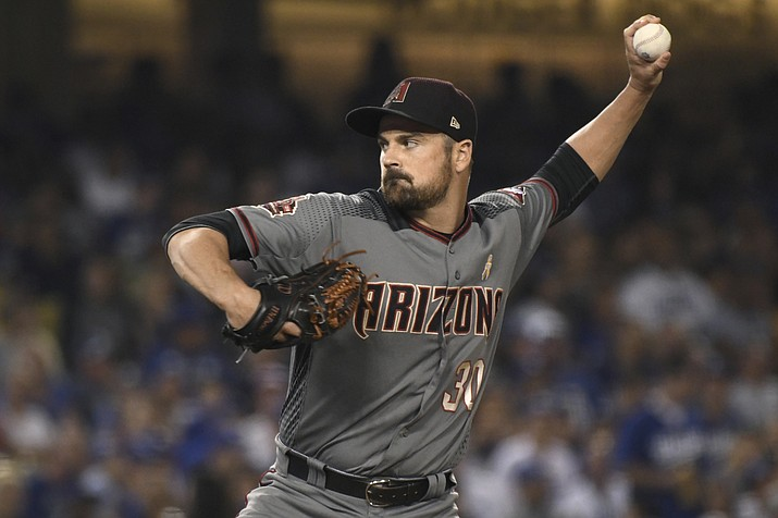 Arizona Diamondbacks pitcher T.J. McFarland throws to the plate during a baseball game against the Los Angeles Dodgers, Saturday, Sept. 1, 2018, in Los Angeles. (Michael Owen Baker/AP)