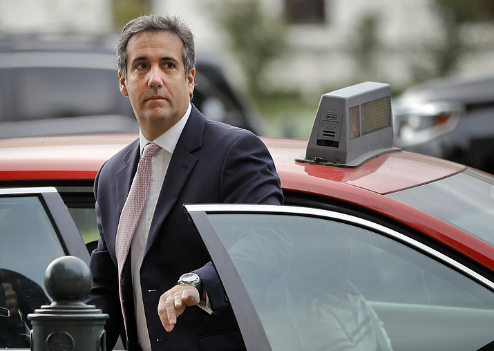 In this Sept. 19, 2017, file photo, Michael Cohen, President Donald Trump's personal attorney, steps out of a cab during his arrival on Capitol Hill in Washington. Cohen won't appear as scheduled before the House Oversight and Reform Committee on Feb. 7, 2019. Cohen's adviser Lanny Davis says the delay is on the advice of Cohen's lawyers because Cohen's still cooperating in special counsel Robert Mueller's Russia investigation. (Pablo Martinez Monsivais/AP, file)
