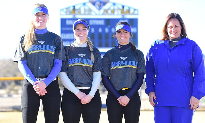 Embry Riddle freshman Mikaeli Davidson, junior Bailey Critchlow, senior Carly Carlsen along with Head Coach Christi Ambrosi pose for a photo before softball practice Thursday, Jan. 24, 2019 in Prescott. (Les Stukenberg/Courier)