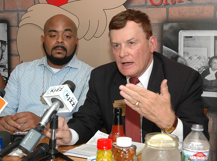 Rep. David Stringer last year explaining his comments about race and immigration to a group of African-Americans brought together by the Rev. Jarrett Maupin, left. (Howard Fischer, Capitol Media Services file photo)