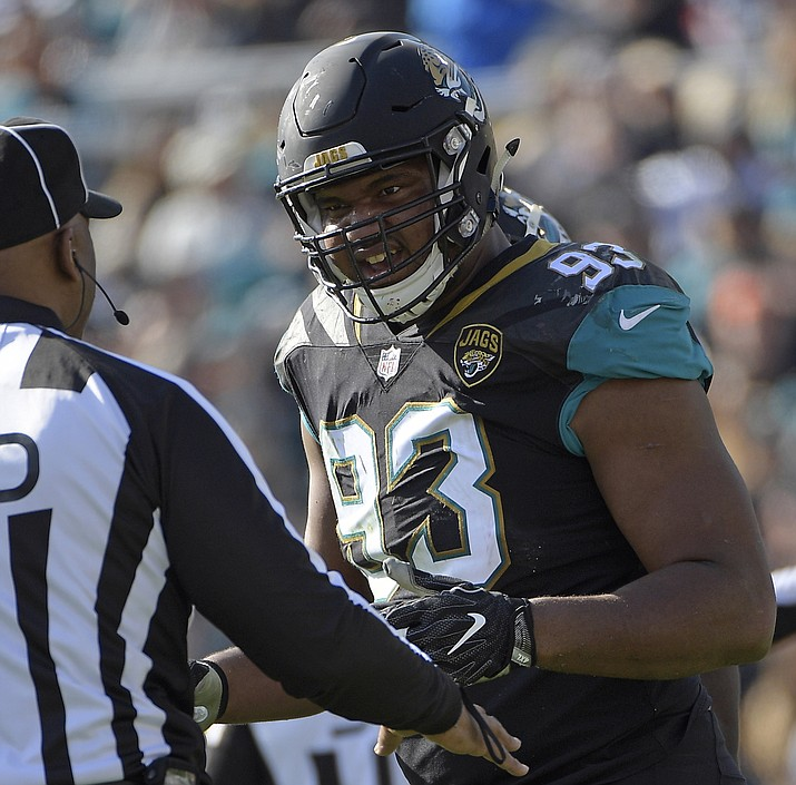 Jacksonville Jaguars defensive end Calais Campbell (93) has a discussion with an official in the first half of a Jan. 7, 2018, NFL wild-card playoff football game against the Buffalo Bills, in Jacksonville, Fla. Campbell watched the NFL's conference championship games on his phone while flying home from South Africa last weekend. Campbell was stunned officials chose not to penalize Robey-Coleman for flattening Saints receiver Tommylee Lewis before the ball arrived. (Phelan M. Ebenhack/AP, File)