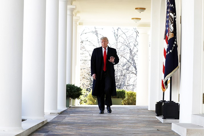 President Donald Trump walks from the Oval Office to speak in the Rose Garden of the White House to announce a temporary end to the partial government shutdown, Jan. 25, 2019. (AP Photo/Jacquelyn Martin)
