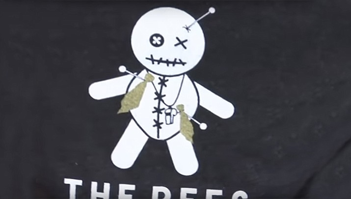 New Orleans Saints fans and business owners have started printing and selling T-shirts featuring a referee voodoo doll with pins sticking out of it. (AP)
