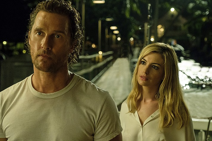 """This image released by Aviron Pictures shows Matthew McConaughey, left, and Anne Hathaway in a scene from """"Serenity."""" (Graham Bartholomew/Aviron Pictures via AP)"""