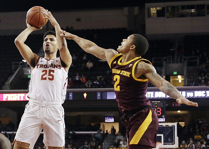Southern California forward Bennie Boatwright (25) shoots next to Arizona State guard Rob Edwards (2) during the first half of an NCAA college basketball game Saturday, Jan. 26, 2019, in Los Angeles. Boatwright's 3-pointer with 14 seconds remaining solidified the win for USC. (Marcio Jose Sanchez/AP)