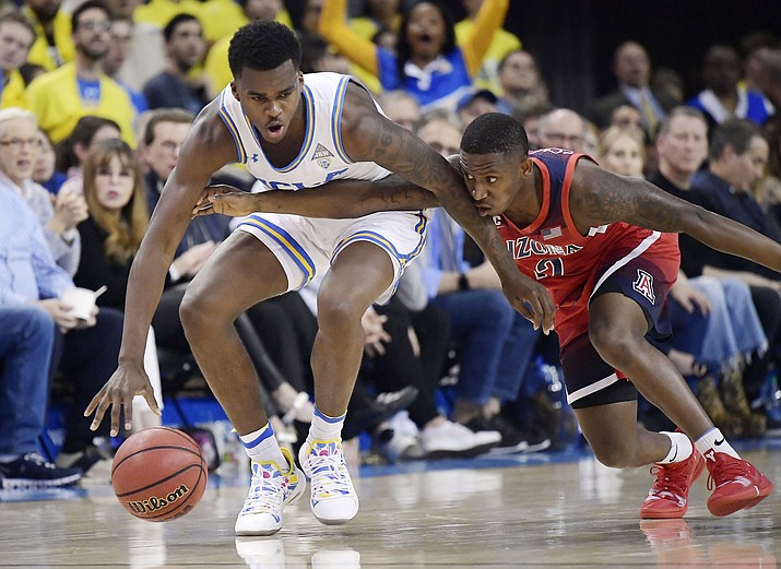 Arizona guard Justin Coleman, right, reaches for the ball against UCLA guard Kris Wilkes during the first half of an NCAA college basketball game Saturday, Jan. 26, 2019, in Los Angeles. (Mark J. Terrill/AP)