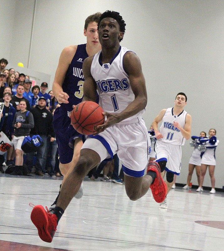 Kingman Academy's Tyler Chinyere led all scorers Friday night with 30 points in a 72-48 victory over Wickenburg. (Photo by Beau Bearden/Daily Miner)