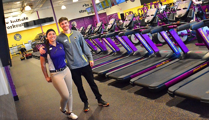 "Cottonwood Planted Fitness Manager KayLynn Carrizoza and fitness instructor Caleb Hillis stand in the ""Judgment Free Zone"" Tuesday. VVN/Vyto Starinskas"