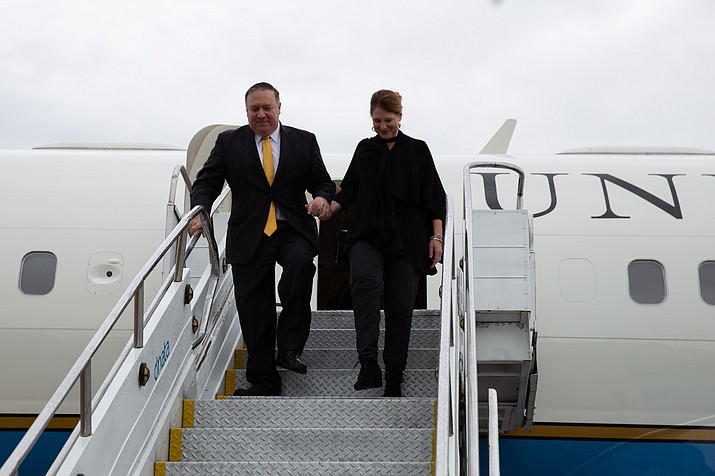 In this Jan. 1, 2019 file photo, U.S. Secretary of State, Michael Pompeo, and Mrs. Pompeo arrived in Brasília to participate in the Preisdent-elect Jair Bolsonaro's inauguration. Saturday, Pompeo encouraged the United Nations Security Council to recognize Juan Guaido as the constitutional interim President of Venezuela. (Photo by U.S. Embassy Brasilia, Public domain)