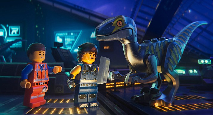 "This image released by Warner Bros. Pictures shows the characters Emmet, left, and Rex Dangervest, center, both voiced by Chris Pratt, in a scene from ""The Lego Movie 2: The Second Part."" (Warner Bros. Pictures via AP)"