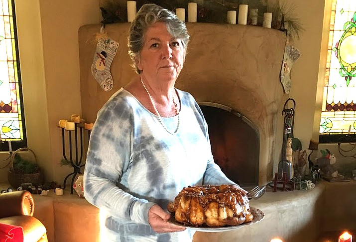 Carol Redenbaugh offers Bubble Rolls, a Redenbaugh family tradition.
