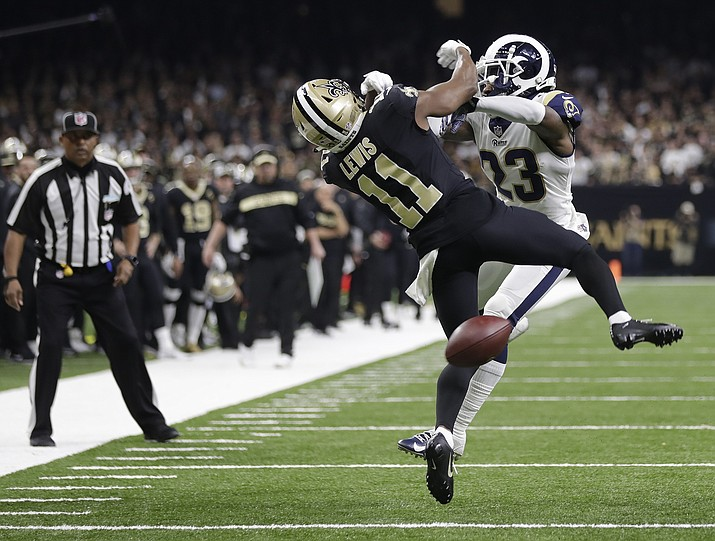 "In this Sunday, Jan. 20, 2019 file photo, New Orleans Saints wide receiver Tommylee Lewis (11) works for a catch against Los Angeles Rams defensive back Nickell Robey-Coleman (23) during the second half the NFL football NFC championship game, in New Orleans. The Rams won 26-23. New Orleans Saints fans have found some pretty creative ways to express their displeasure over the infamous ""no call"" during last weekend's Saints-Rams championship game. But their newest tactic may make the loudest statement - a Super Bowl boycott. (Gerald Herbert/AP, file)"