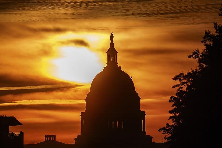 The rising sun silhouettes the U.S. Capitol dome at daybreak Oct. 26, 2018, in Washington. (Alex Brandon/AP, File)