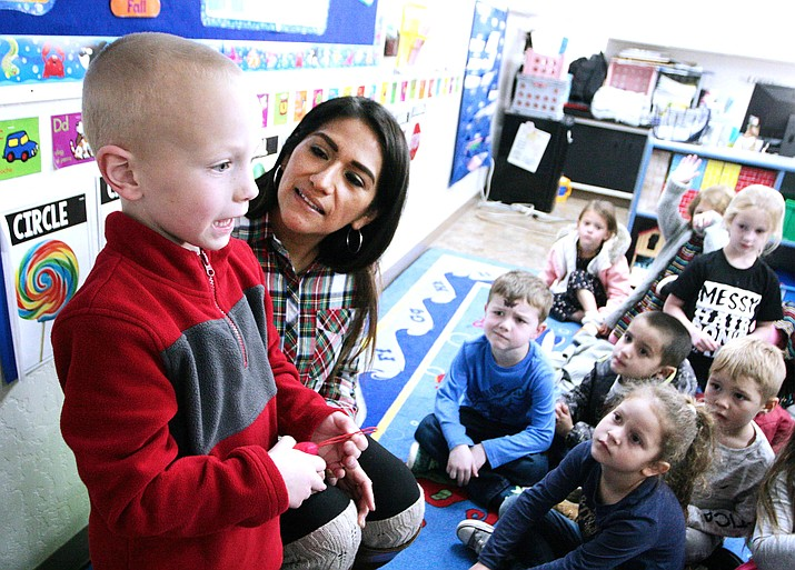 Lizette Farraro, an assistant preschool teacher at Verde Christian Academy, watches as five-year-old Lucas Shires addresses his fellow classmates. The school's preschool program recently was recognized by Quality First with a five-star rating. VVN/Bill Helm