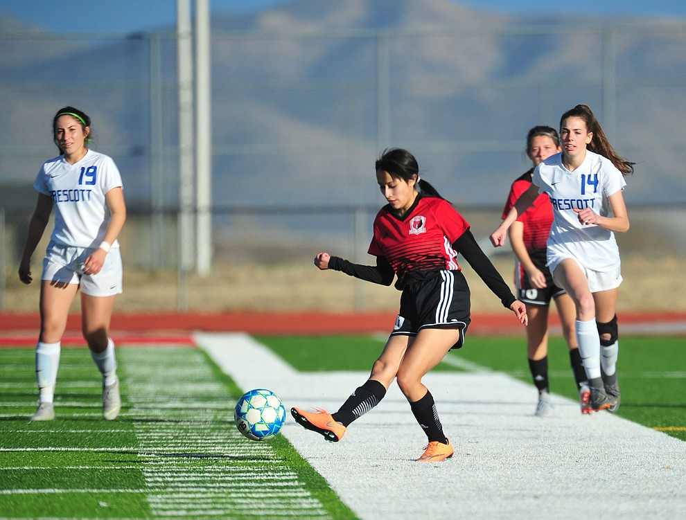 Bradshaw Mountain's Genessa Alvarado clears the ball as the Bears play the Prescott Badgers Tuesday, Jan. 29, 2019 in Prescott Valley. (Les Stukenberg/Courier).