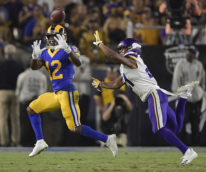 Los Angeles Rams wide receiver Brandin Cooks catches a pass in front of Minnesota Vikings cornerback Mike Hughes during the second half in an NFL football game Thursday, Sept. 27, 2018, in Los Angeles. (Mark J. Terrill/AP)