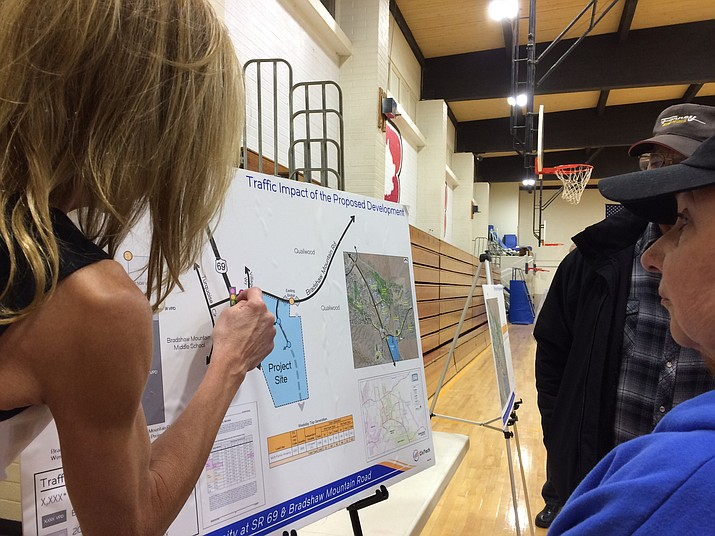 Tove White, Civ Tech project manager, left, points out the intersection of Highway 69 and Bradshaw Mountain Road to Quailwood residents who attended the Dorn Homes Open House in the Bradshaw Mountain Middle School gym on Jan 22. (Sue Tone/Tribune)