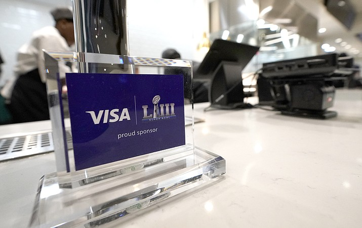 A Visa sponsorship sign sits on a restaurant counter at Mercedes-Benz Stadium during a tour for the NFL Super Bowl 53 football game Tuesday, Jan. 29, 2019, in Atlanta. During its sponsorship renewal with the NFL through the 2025 season, Visa envisions the first cashless Super Bowl. (David J. Phillip/AP)