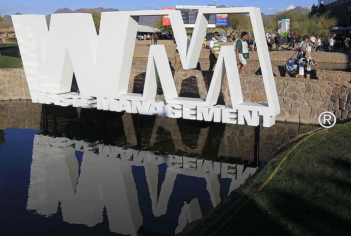 The tournament sponsor logo Waste Management sits above a water hazard at the 15th green during the second round of the Phoenix Open golf tournament Friday, Feb. 3, 2012, in Scottsdale, Ariz.(Ross D. Franklin/AP)