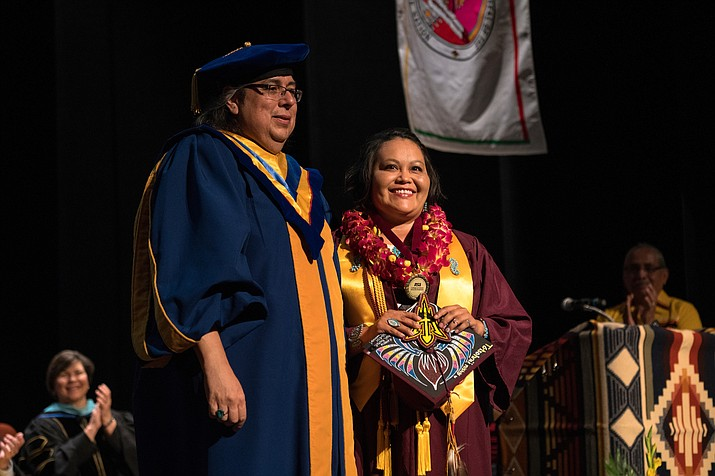 Jamie Tsosie, an applied sciences major, receives the Dukepoo award at ASU's Gammage Theater. The American Indian Convocation is a celebration of all of the graduating American Indian students at Arizona State University. (Photo by Marcus Chormicle/ASU Now)