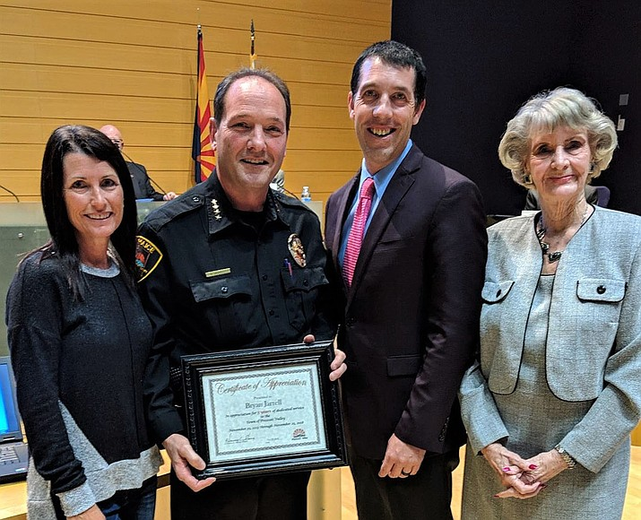 PVPD Chief Bryan Jarrell, second from left, receives recognition for five years of service with the town at the Jan. 24 Town Council meeting. From left, Tina Jarrell, Chief Jarrell, Mayor Kell Palguta and Vice Mayor Lora Lee Nye. (PVPD/Courtesy)
