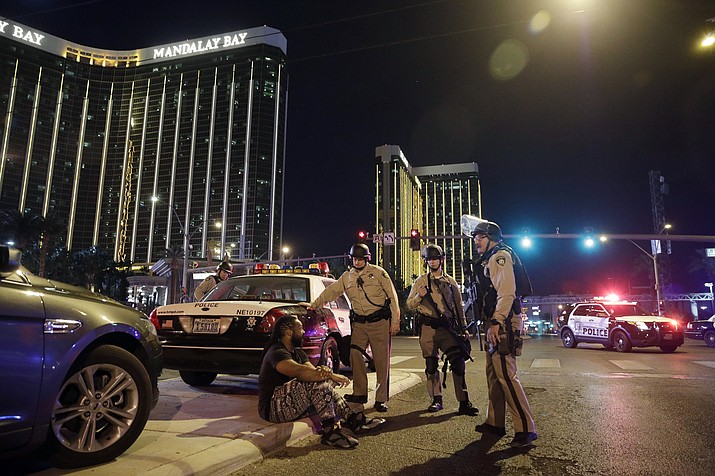 In this Oct. 1, 2017 file photo, police officers stand at the scene of a shooting near the Mandalay Bay resort and casino on the Las Vegas Strip in Las Vegas. In a report released Tuesday, Jan. 29, 2019, the FBI concluded its investigation into the deadliest mass shooting in modern U.S. history without determining a motive. After nearly 16 months, the agency says it can't determine why gunman Stephen Paddock killed 58 people and injured nearly 900 others in October 2017. (John Locher/AP, file)