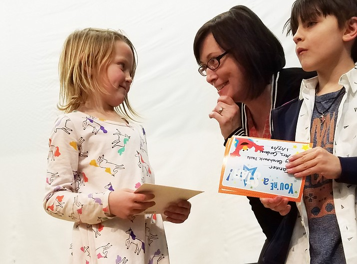 Reese Skinner, a first grade student at Williams Elementary-Middle School, receives an academic award from Principal Carissa Morrison during the K-2 award assemblyJan. 17. (Submitted photo)