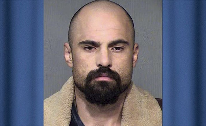 In this undated photo provided by the Maricopa County Sheriff's Office is Michael Lee Crane of Mesa, Arizona. Crane pleaded guilty on Monday, Jan. 28, 2019, to murder in the 2012 deaths of a cigar salesman in Phoenix and a couple from an upscale suburb in burglaries that ended with the victims being killed and their homes set on fire. (Maricopa County Sheriff's Office via AP)