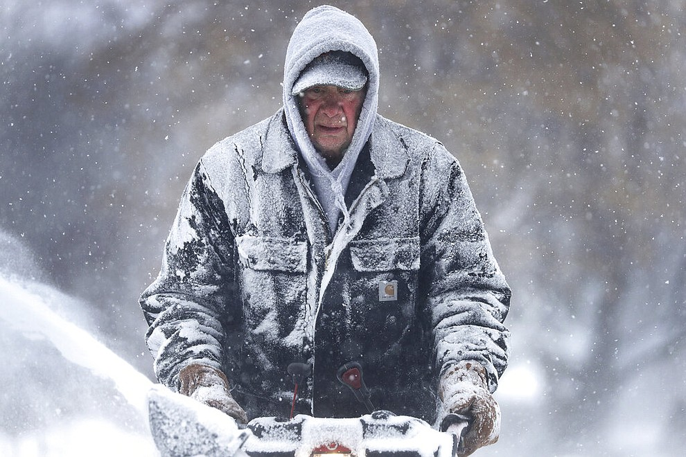 Gary Verstegen clears a sidewalk as a winter storm moves through Wisconsin on Monday, Jan. 28, 2019, in Little Chute, Wis. (William Glasheen/The Post-Crescent via AP)