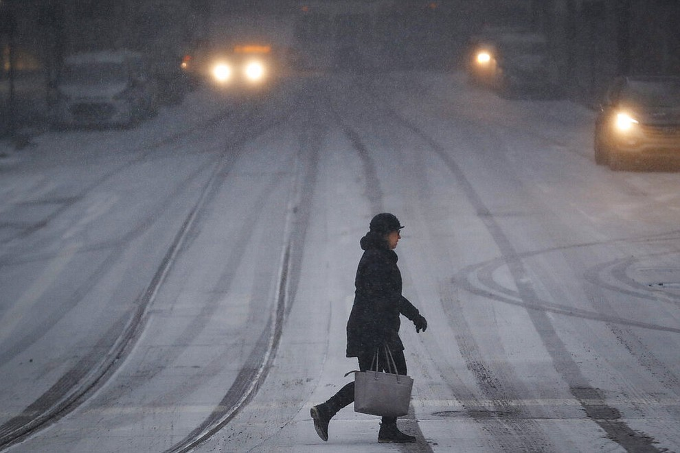 A commuter braves the wind and snow in frigid weather, Wednesday, Jan. 30, 2019, in Cincinnati. The extreme cold and record-breaking temperatures are crawling into a swath of states spanning from North Dakota to Missouri and into Ohio after a powerful snowstorm pounded the region earlier this week. (AP Photo/John Minchillo)