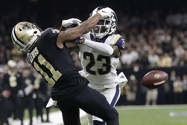 "In this Jan. 20, 2019, file photo, Los Angeles Rams' Nickell Robey-Coleman breaks up a pass intended for New Orleans Saints' Tommylee Lewis during the second half of the NFL football NFC championship game in New Orleans. Robey-Coleman says he received ""one or two"" death threats from frustrated New Orleans Saints fans on social media after the NFC championship game.  (Gerald Herbert/AP, File)"