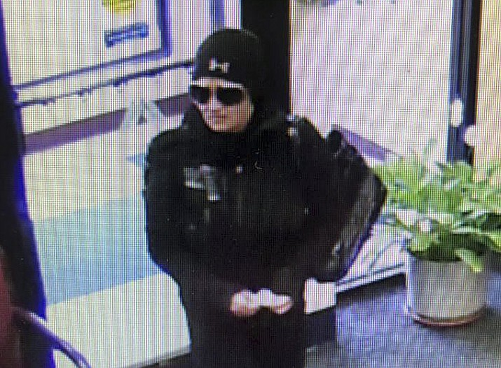 This Monday, Jan. 28, 2019 surveillance image released by the Fall River, Mass., Police Department on its Facebook page shows a female suspect in an attempted robbery of the Fall River Municipal Credit Union, who got cold feet and left without a penny. The police are looking for the suspect. (Fall River Police Department Facebook page)