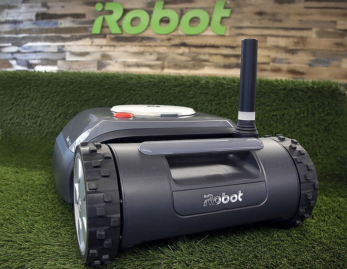 An iRobot Terra lawn mower Jan. 16, 2019, in Bedford, Mass. Building a robot lawn mower seemed the logical next step for iRobot, which invented the pioneering robotic vacuum Roomba. But the company's secret, decade-plus lawn mower project was a lot harder than anyone expected. (Elise Amendola/AP)