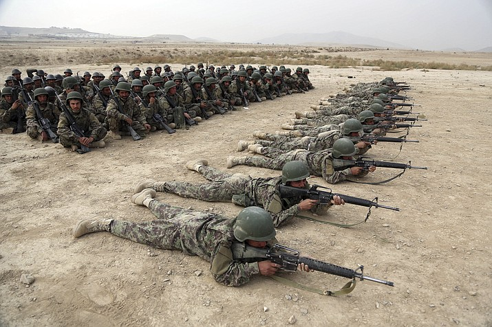 In this Oct. 31, 2018, photo, Afghan National Army (ANA) soldiers carry out an exercise during a live firing at the Afghan Military Academy in Kabul, Afghanistan. Trump administration claims of progress in talks with the Taliban have sparked fears even among allies of the president that his impatience with the war in Afghanistan will lead him to withdraw troops too soon, leaving the country at risk of returning to the same volatile condition that prompted the invasion in the first place. (AP Photo/Rahmat Gul, File)