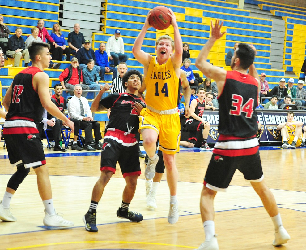 Embry Riddle's Kaden Herbert cuts between a trio of defenders as the Eagles take on the Simpson University Redhawks Thursday, Jan. 31, 2019 in Prescott. (Les Stukenberg/Courier).