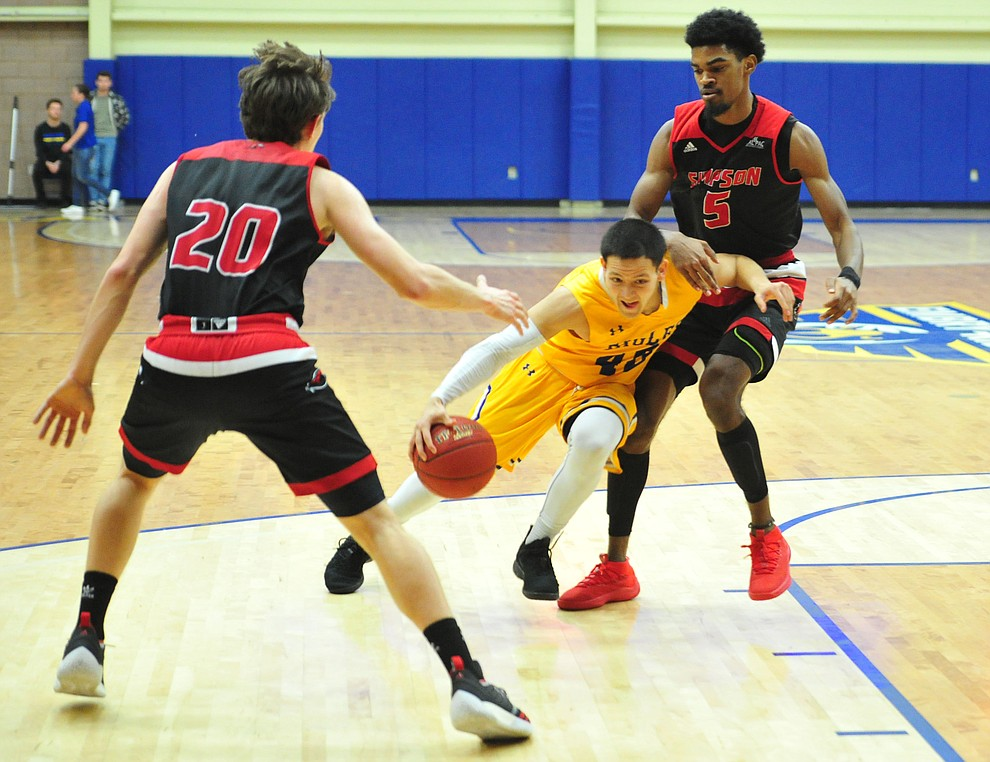 Embry Riddle's Conner Verdugo cuts between a pair of defenders as the Eagles take on the Simpson University Redhawks Thursday, Jan. 31, 2019 in Prescott. (Les Stukenberg/Courier).